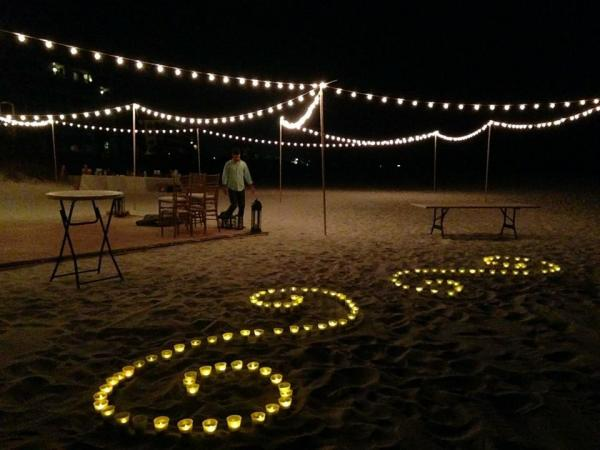 Pipe and draping wedding wall draping cafe lighting twinkle cafe lighting and candle light designs in the sand in destin florida mozeypictures